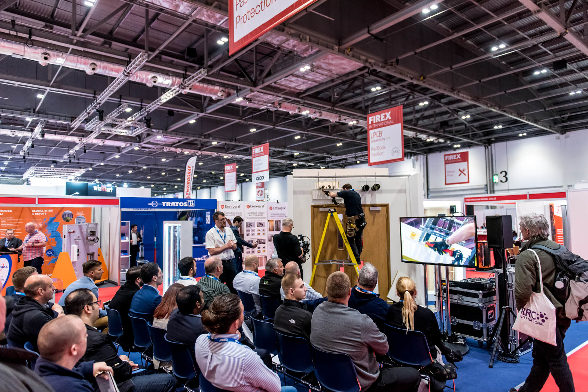 An Installer demonstrating their product at FIREX 2019